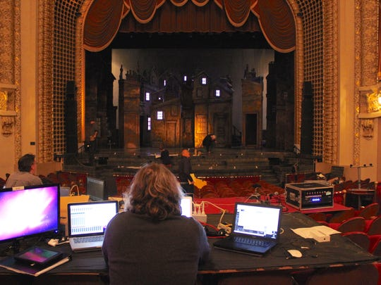 """Sound designer Barry G. Funderburg works as the new """"Christmas Carol"""" set is loaded in the Pabst Theater."""