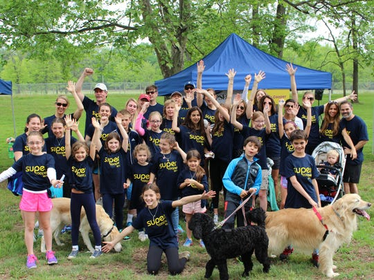 Team Super Cooper, formed to celebrate Morristown resident and former CSH patient Cooper Weil, gathered at a recent Children's Specialized Hospital Foundation-sponsored Walk 'n Roll event to help raise money for the hospital.