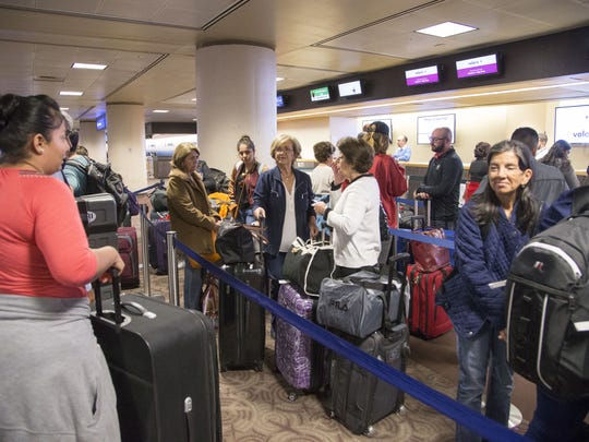 Passengers wait in line at Phoenix Sky Harbor International