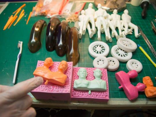 Craig Blankenship meticulously repairs plastic figures,