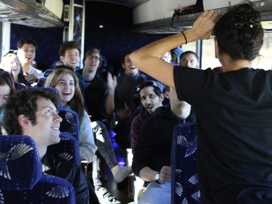 """Cincinnati Ballet's Maizyalet Velázquez leads a session of """"Heads Up!"""" on the bus to pass the time on the trip to the nation's capital."""