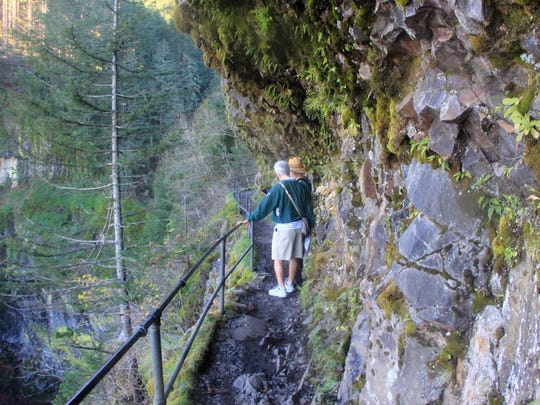 The trail to Upper McCord Creek Falls tightropes along the edge of a cliff but is protected by guardrails.
