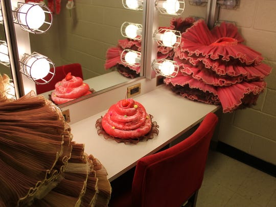 """Some of the youngest dancers in the Cincinnati Ballet's production of """"The Nutcracker"""" portray cupcakes. Here is the """"frosting"""" – the hat – of one of the young cupcakes."""
