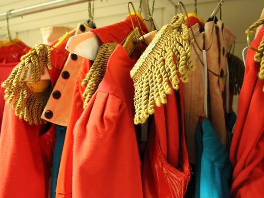 """Fringed epaulets decorate the brashly colored costumes of the army of soldiers who will do battle with the Mouse King in Cincinnati Ballet's production of """"The Nutcracker."""""""