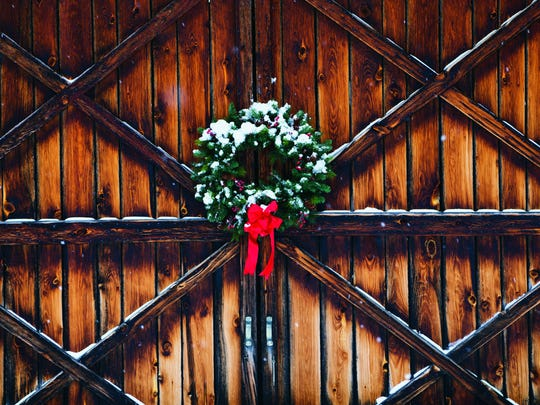 A weathered door on a barn owned by George LaCross in Leelanau County was adorned a Christmas wreath and a little snow for the photo shoot. It became the cover of Cabela's Christmas catalog this  year.