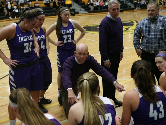 Indianola coach Bert Hanson talks to his team during a timeout.