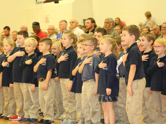 The first grade class at John Paul II Catholic School lead the Veterans and their families in the Pledge of the Allegiance during the annual Veterans Day program.