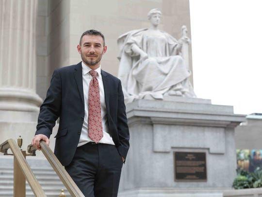 Criminal defense attorney Jeff Cardella stands in front of the Justice Statue at the Birch Bayh Federal Building and United States Courthouse on Tuesday,  Nov. 22, 2016.