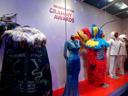 In this Wednesday, March 2, 2016 photo, finishing touches are being applied to the exhibits, like this one of performance outfits, at the Grammy Museum Mississippi in Cleveland, Miss. The second and only official Grammy Museum outside of Los Angeles opens Saturday in the Mississippi Delta, cradle of the blues. Organizers chose Cleveland, Miss. - two hours north of the state capitol Jackson - for the nearly $20 million project and promise one of the most advanced museums in the country. (AP Photo/Rogelio V. Solis)