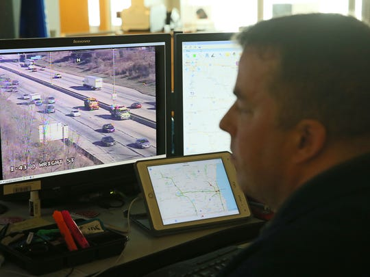 Brent Bowgren, a control room supervisor with the Wisconsin Department of Transportation, watches a traffic camera trained on I-43 at Wright St. where a road repair crew works Monday on Milwaukee's freeway system.