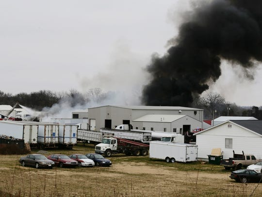 Black smoke rises from a fire at IGD Environmental Services in Central City on Thursday, November 24, 2016.