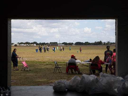 Hundreds of people from the Immokalee community came out on Thanksgiving Day to receive a meal donated by the Guadalupe Center and St. John the Evangelist Catholic Church at Airport Park Thursday, Nov. 24, 2016 in Immokalee.