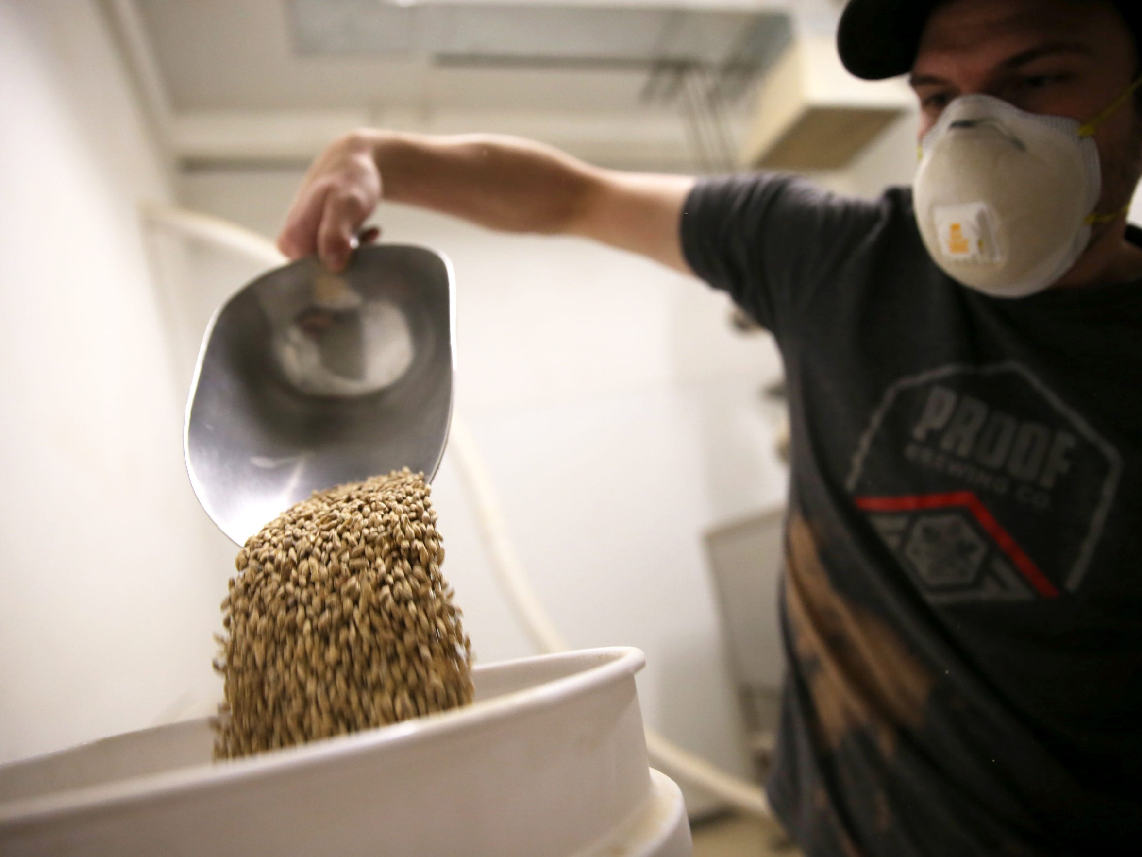 Brewer Jordan Outlaw measures grains for the Mango