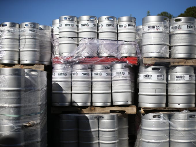 Kegs are stacked outside of Proof Brewing Company on