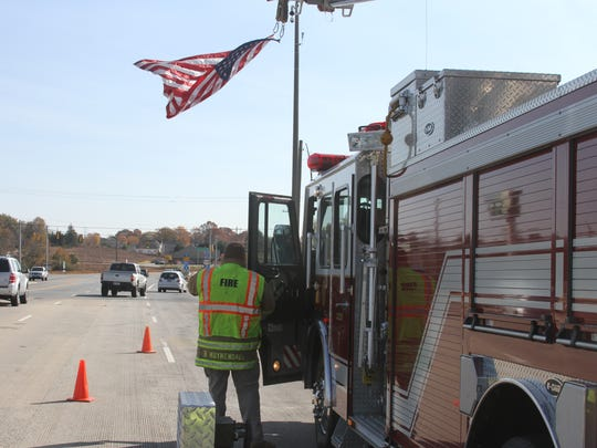 The Powdersville fire department was one of several that honored the funeral procession for Patrick Carothers with a flag over the S.C. 153 overpass along Interstate 85 in Anderson County on Sunday afternoon. The Townville Fire Department also participated at the overpass at S.C. 24.