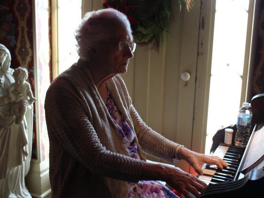 Barbara Piatt, a Mansfield resident and Oak Hill Cottage volunteer, plays the pump organ in the second-floor chapel at the cottage Sunday, Nov. 27, 2016. Piatt has played the piano since she was five and has played Christmas songs on the late 19th century-organ at the cottage for several years.