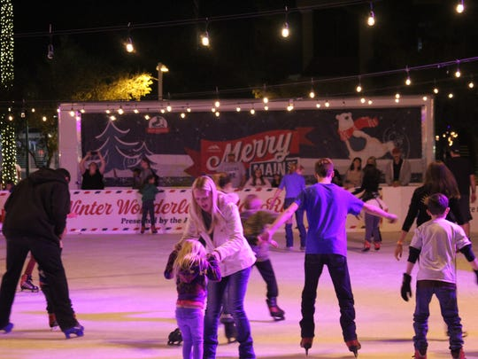 Skaters take on a 4,500-square-foot rink at a past Merry Main Street festival in Mesa. The civic center plaza will have a dedicated space for the ice rink.