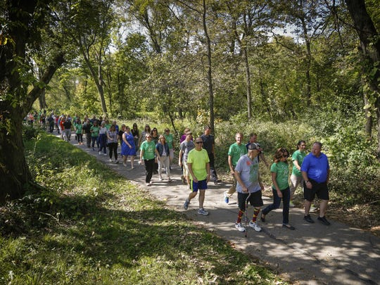 Walkers take to the Clive Greenbelt trail for a 1K walk as part of the healthiest state initiative Wednesday, Oct. 7, 2015.