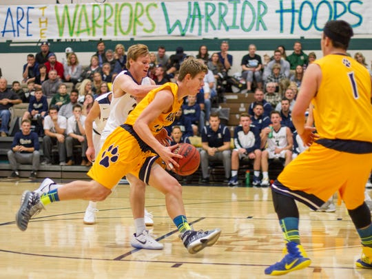 Snow Canyon and Enterprise basketball battle it out at Snow Canyon High School Wednesday, Nov. 30, 2016.