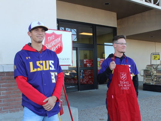 Salvation Army bell ringers and their red kettles are