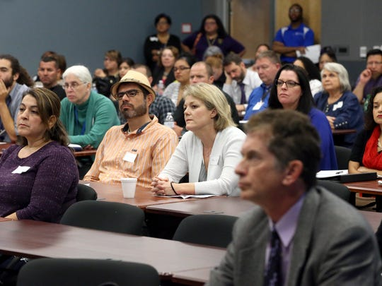 People attend Stop the Silence on Domestic Violence Summit on Friday, Dec. 2, 2016, at the Del Mar College Center for Economic Development in Corpus Christi.