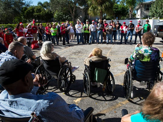The Gator Alley Chapter of ABATE of Florida sings Christmas carols to residents of Heritage Healthcare during the 30th annual Heritage Healthcare holiday event on Sunday, Dec. 4, 2016. ABATE of Florida is a nonprofit motorcycle organization that promotes motorcycling in a safe and positive image.