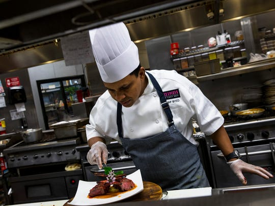 Executive chef Asif R. Syed prepares a specialty lamb