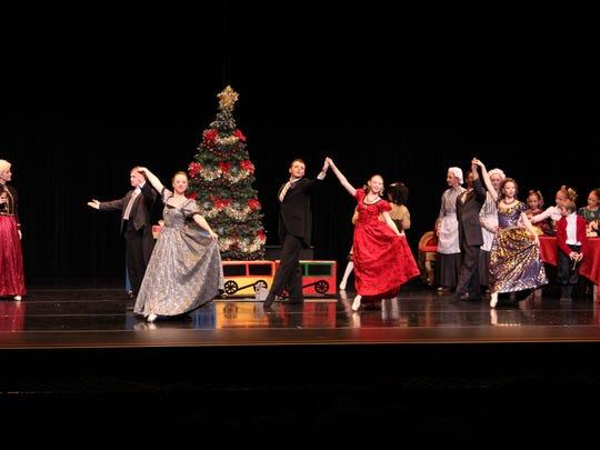 """The party scene in Children's Center for Dance Education's """"The Nutcracker."""""""