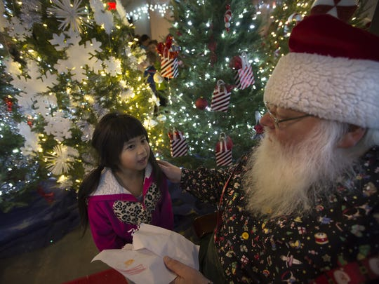 Chia Chi Lor brought Santa a drawing telling him what