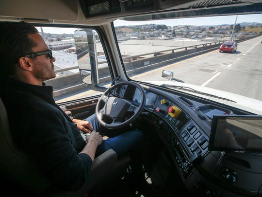 Matt Grigsby, senior program engineer at Otto, takes his hands off the steering wheel of the self-driving, big-rig truck during a demonstration on the highway in August 2016 in San Francisco.