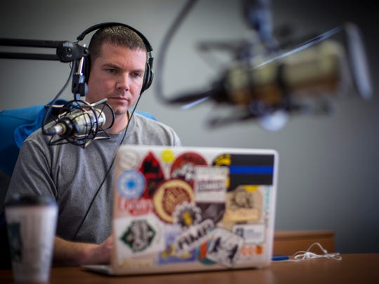 Gabe Glynn work on his advanced manufacturing podcast at an office Thursdsay Dec. 8, 2016, in Des Moines. Glynn, a youngish entrepreneur from Ankeny who has a background in marketing and web development. He left his web development firm probably about 9 months to a year ago to work on a new wearable technology, Makusafe, that's meant to reduce safety incidents in manufacturing plants. http://makusafe.com/#/explore