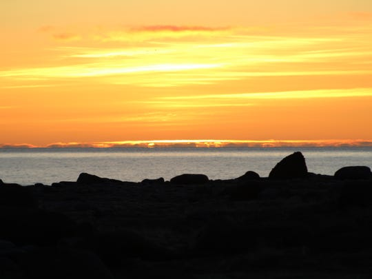 Richard Hoben of Pineville took a photo on of the sunset while on the black sanded beach in Iceland. Hoben took a two-week trip to Iceland.