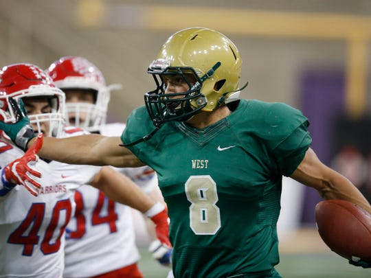 "Iowa City West's Oliver Martin (8) is receiving national interest, so Iowa will have to work hard to earn a recruiting coup. ""You've got to protect your borders, and a lot of people are paying attention to his recruitment,"" says Hawkeye Report editor Blair Sanderson. ""And there's a need at receiver. He would be vital for numbers and talent."""