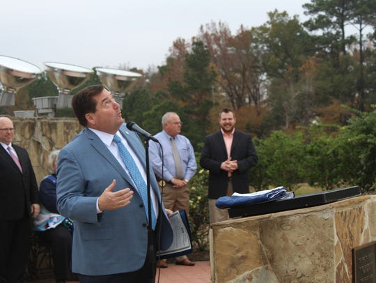 Lieutenant Gov. Billy Nungesser looks up at the 199-foot