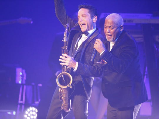 Saxaphonist Dave Koz, left,  performs songs as part