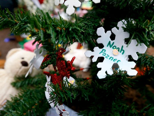 A snowflake ornament with the name of 6-year-old Noah