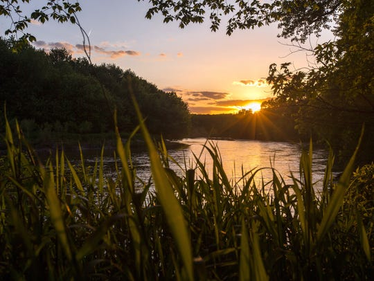 The sun sets over the Raccoon River in Sac County Wednesday,