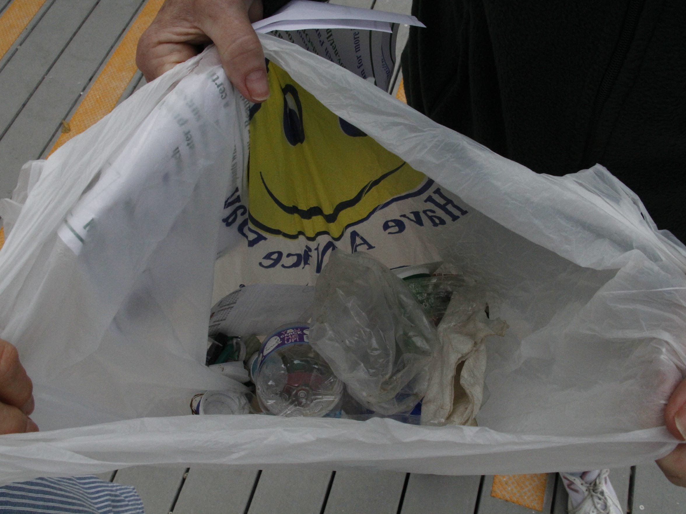 A volunteer collected a grocery bag full of trash within