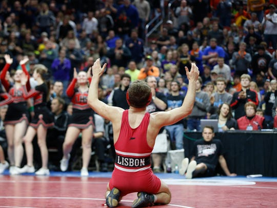 Lisbon's Carter Happel celebrates his win in the 145 title match Saturday, Feb. 20, 2016 during the class 1A state wrestling tournament finals in Des Moines.