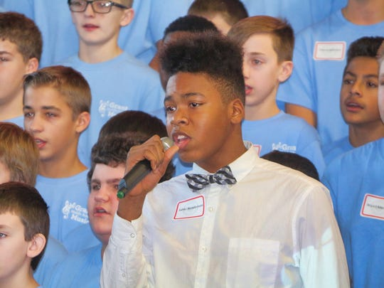 Grant Middle School eighth-grader Jahki Henderson leads the chorus during a song performed at the Grant Leadership Day event held on Dec. 20.