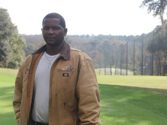 Sean Rossman/Democrat Dwaine Holloman, 48, stands on the 18th green of Hilaman Golf Course on Dec. 16. He started working the grounds at Hilaman while finishing out a 10.5-year prison term. Now he's interim foreman at the course in charge of a handful of employees. Dwaine Holloman, 48, stands on the 18th green of Hilaman Golf Course on Dec. 16. He started working the grounds at Hilaman while finishing out a 10.5-year prison term. Now he's  interim foreman at the course in charge of about a handful of employees.