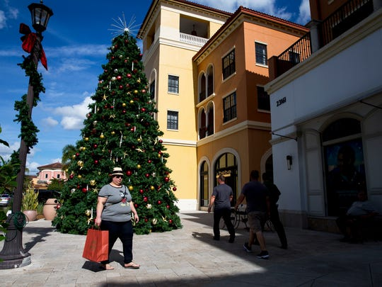 Shoppers walk around Coconut Point mall in Estero, Fla., on Monday, Dec. 26, 2016. Holiday sales and returns surge after Christmas, bringing in crowds of shoppers.