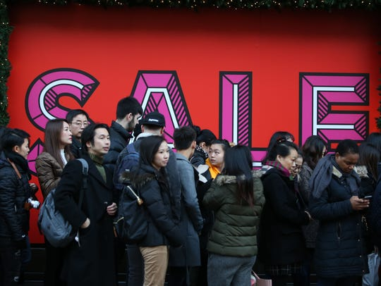 Customers ready to enter the Selfridges department