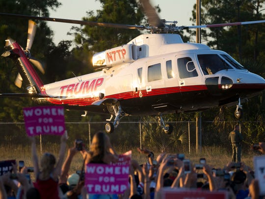 Thousands wave and cheer as Republican presidential nominee Donald Trump takes off after speaking at his rally at the Collier County Fairgrounds on Sunday, Oct. 23, 2016, in Golden Gate Estates.