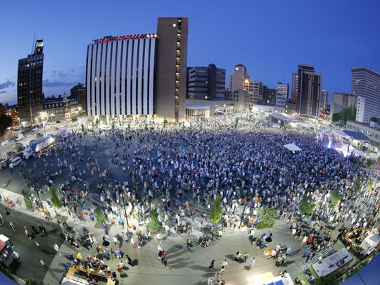 Large attendance at Trombone Shorty & Orleans Avenue at the City of Rochester Midtown Stage during the Xerox Rochester International Jazz Festival.