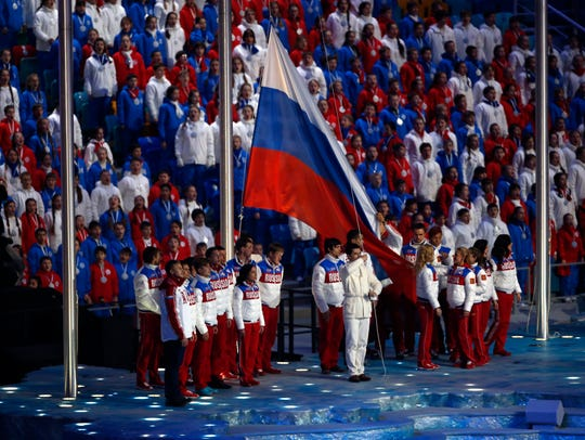 The Russian flag is raised during the closing ceremony