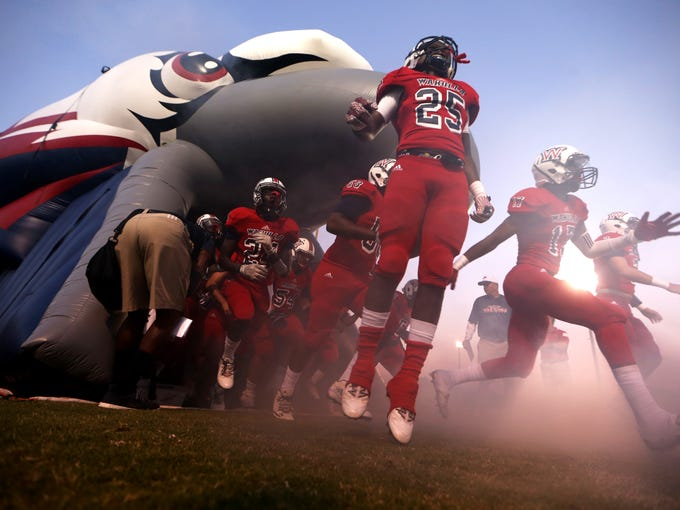 Wakulla's players run out on to the field before their