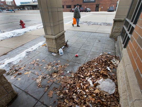 A pile of dead leaves marks the spot where Tanilo Serafin Rios Flores was found after he froze to death outside a liquor store in Walker's Point.