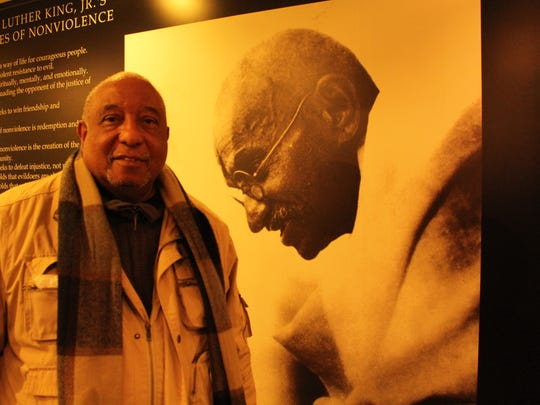 Civil rights icon Bernard LaFayette examines a large likeness of Mahatma Gandhi at the National Voting Rights Museum in Selma. Alvin Benn/Special to the Advertiser
