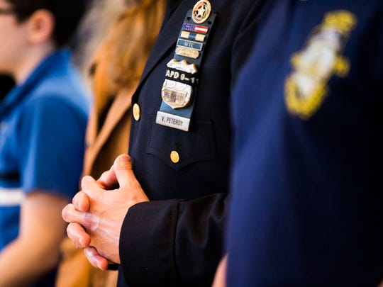 Law enforcement officers pray during Blue Mass for Law Enforcement at St. Agnes Catholic Church in Naples on Saturday, Jan. 7, 2017.